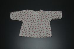 Hvid bluse med multifarvede prikker