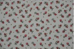 Beige bluse med røde blomster