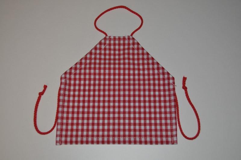 Dukkeforklæde med røde tern