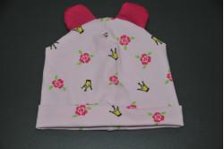 Lyserød dukkehue med serise blomster